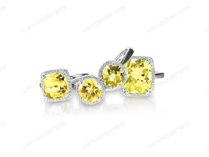 Set of yellow topaz rings gemstone fine jewelry. Group stack of multiple gemstone diamond rings.