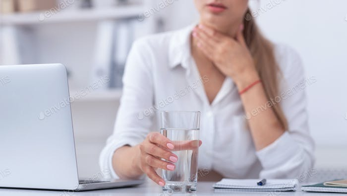 Unrecognizable Sick Girl Working On Laptop At Workplace, Cropped