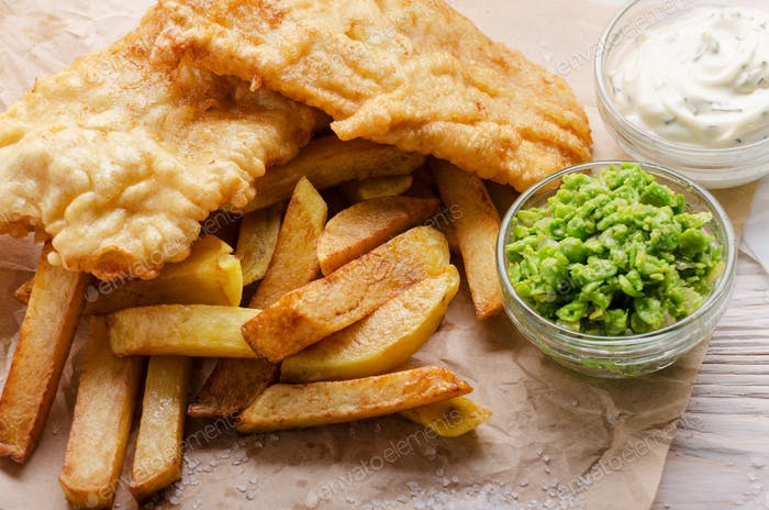 Traditional British street food fish and chips with mushy peas a
