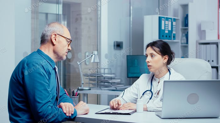 Elderly retired man consulting with doctor