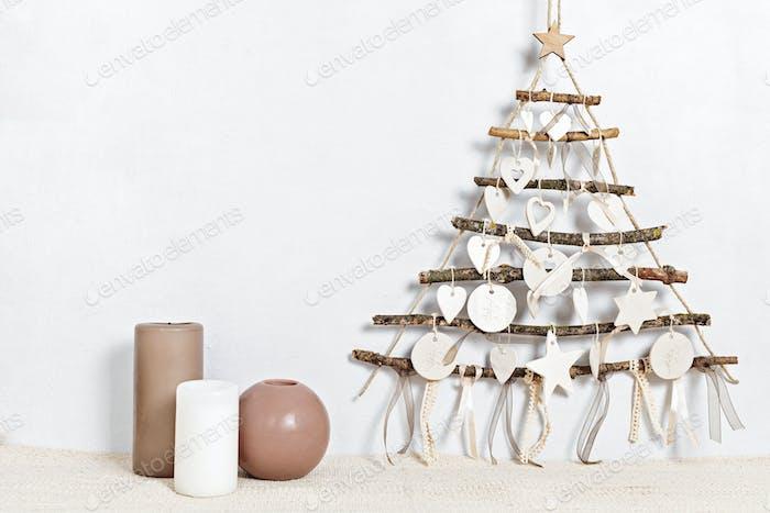 Zero waste christmas with candles and alternative handmade xmas tree