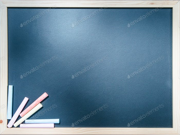 Close-up blackboard with chalks