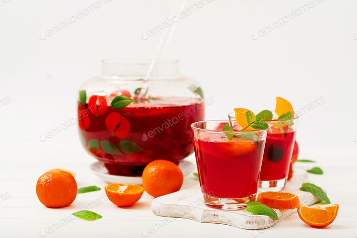Sangria with fruits and mint on a white background