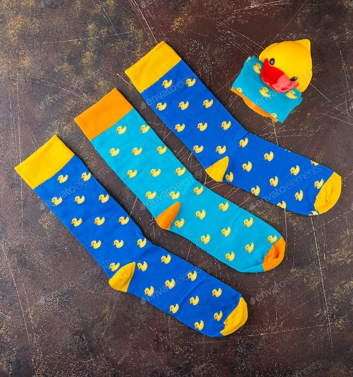 Blue socks with a pattern of yellow ducks