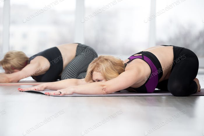 Senior women doing Mandukasana pose