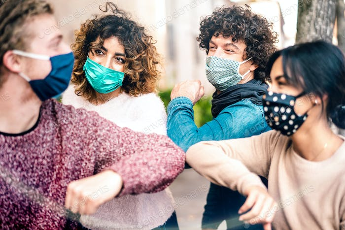 Friends on greeting move wearing face masks