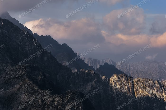 Mountain range landscape view with dramatic clouds and shadows