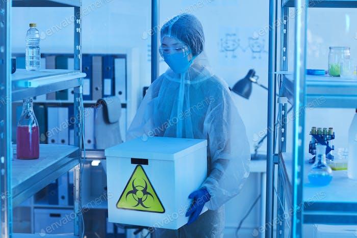 Unrecognizable Female Scientists With Biohazards