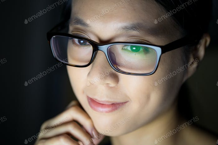 Woman use electronic device at night