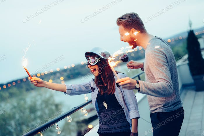 Young couple sparkler celebration happiness togetherness concept