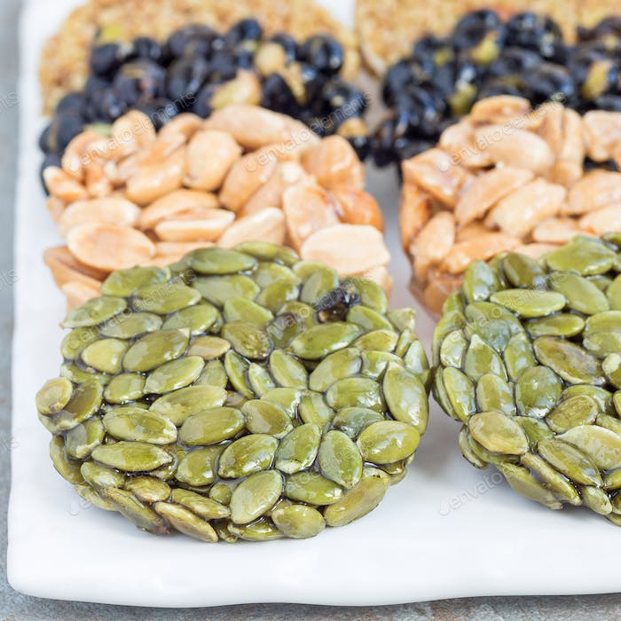 Korean traditional sweet snacks with peanuts, pumpkin seeds, bla