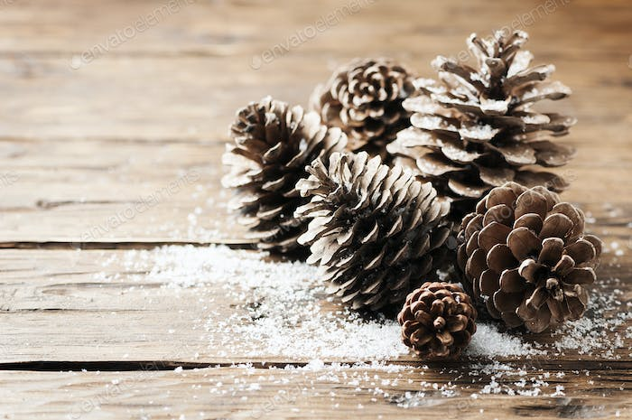 Christmas card with cones on the wooden table