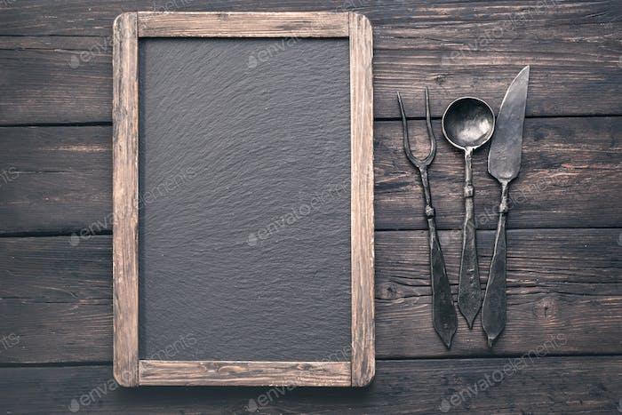 Menu blackboard with stylized cutlery