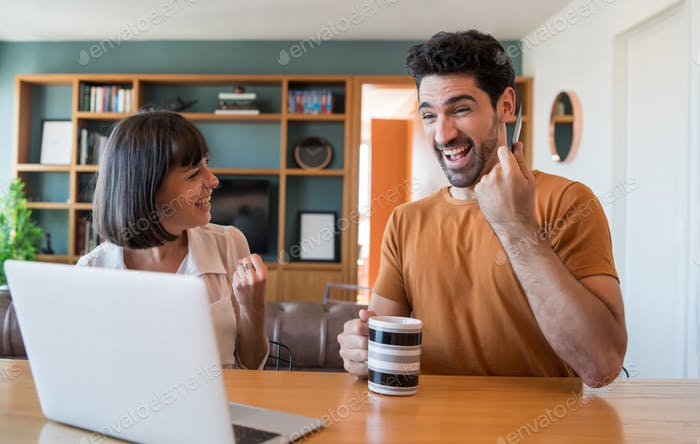 Young couple shopping online from home.