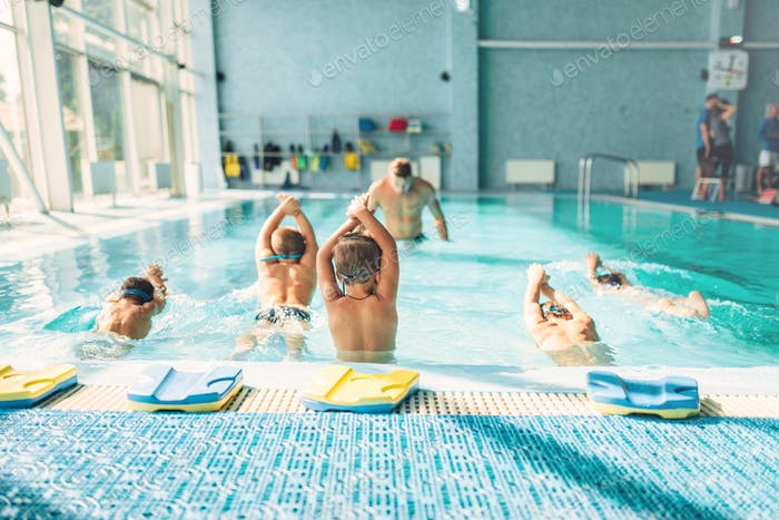 Kids trying to dive in swimming pool