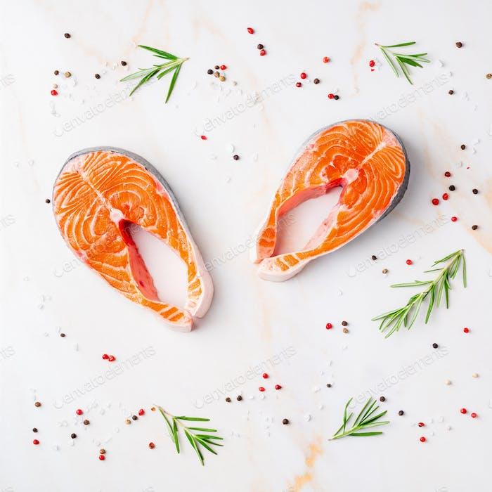 Food background, salmon steaks and seasonings