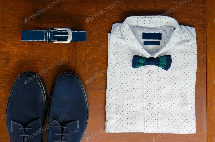 Mens wedding accessory. Mens outfits, white polka-dot shirt with with bow tie, blue belt and shoes