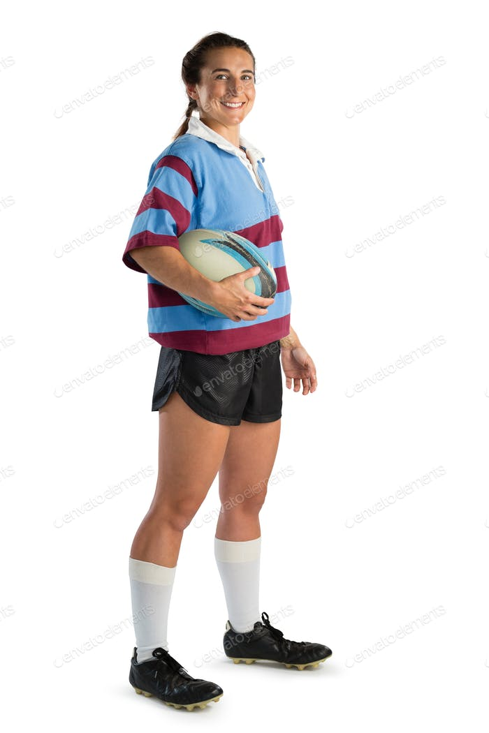 Full length portrait of happy young female player with rugby ball