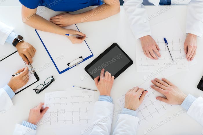 doctors with cardiograms and tablet pc at hospital