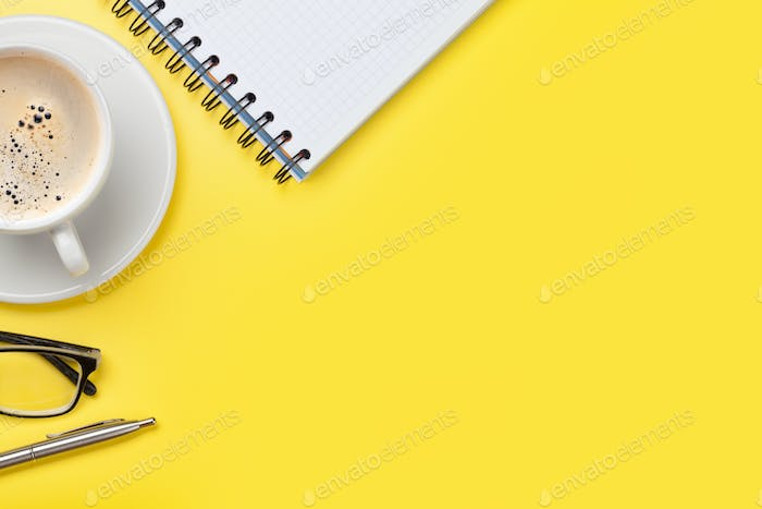 Office yellow workplace with coffee cup and supplies