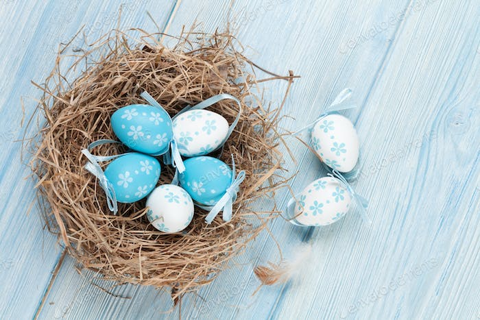 Easter card with eggs in nest