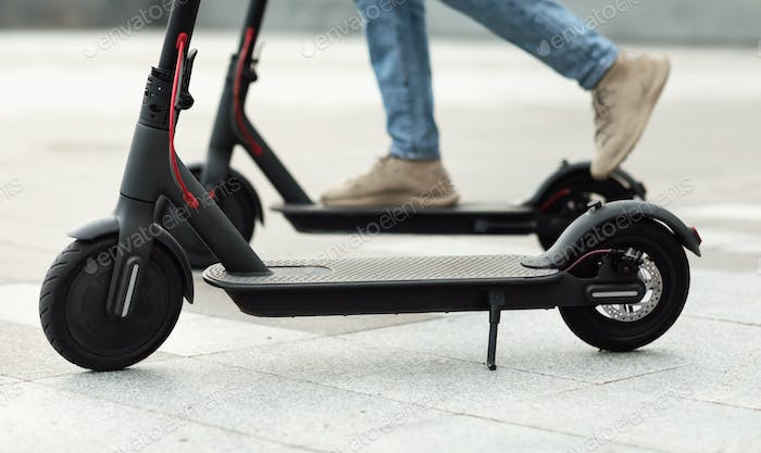 Person having pleasant ride on electric kick scooter