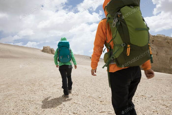 HikingTwo women hikers hiking on sand desert
