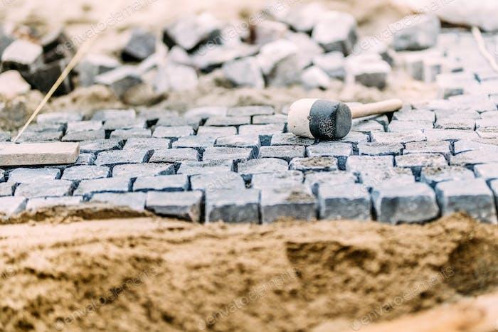 Pavement rocks, granite cobblestone blocks - details of path, road or sidewalk construction