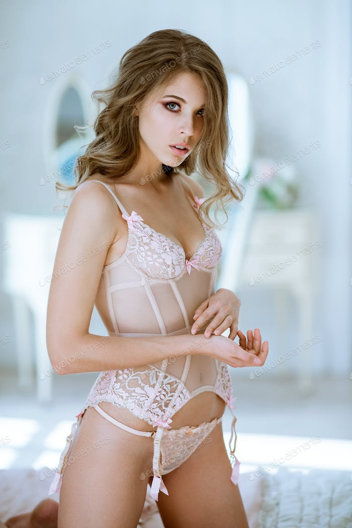 Beautiful sexy lady in pink panties and bra