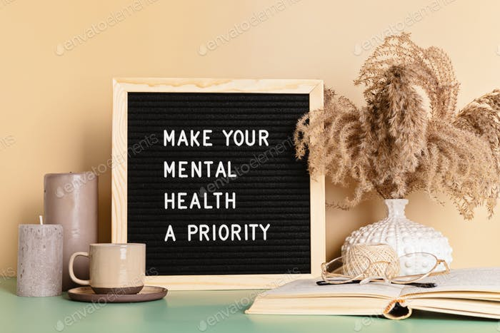 Make your mental health a priority motivational quote on the letter board