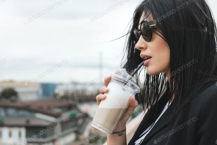 brunette girl keeping takeaway drink