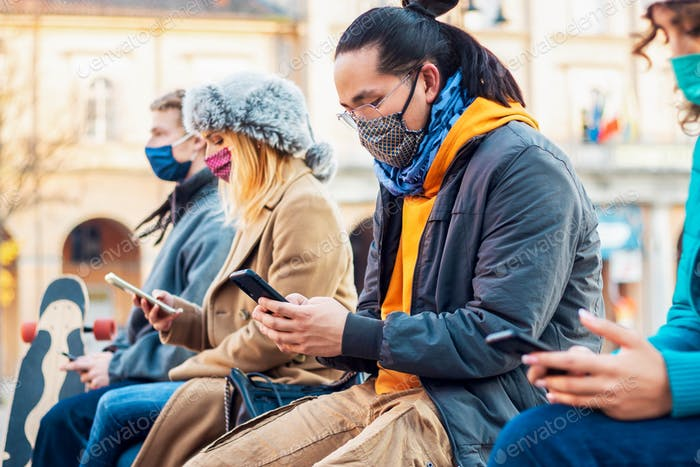 Multiracial friends using mobile phone tracking Coronavirus spread