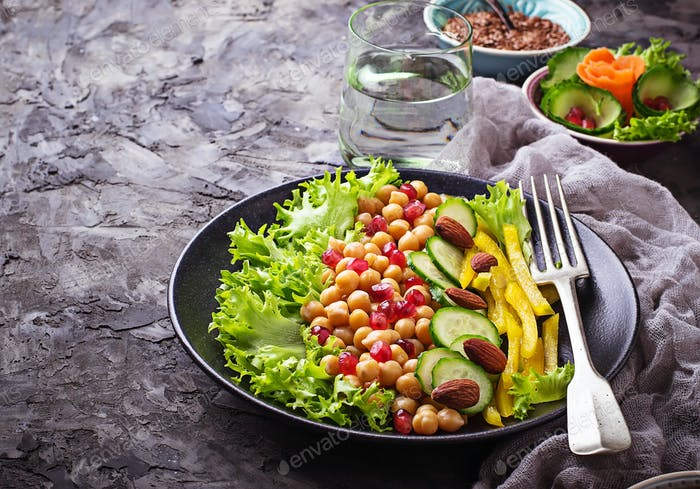 Salad with cucumber, pepper, pomegranate chick-pea