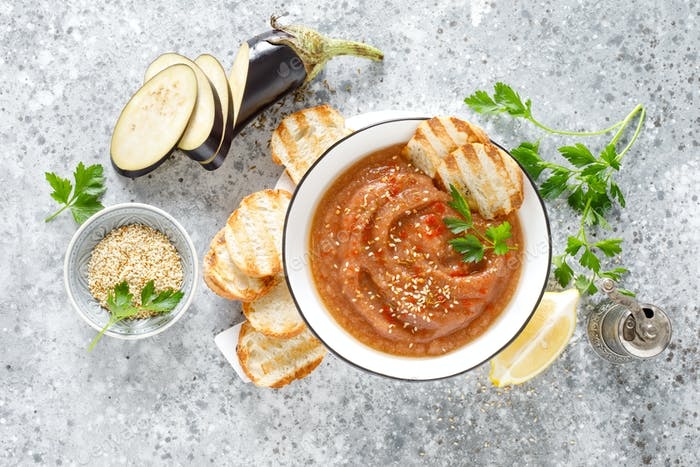 Eggplant hummus with ingredients for cooking. Vegan arabic aubergine appetizer. Baba Ghanoush