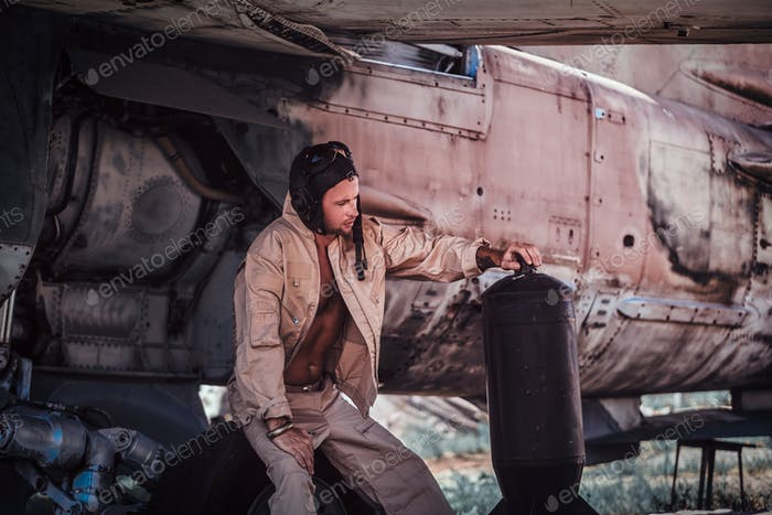 Young pilot with bottle of gasoline