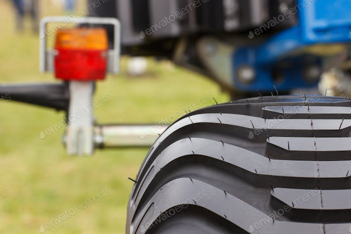 Black tyre and lamp of vehicle or agricultural machine, technology