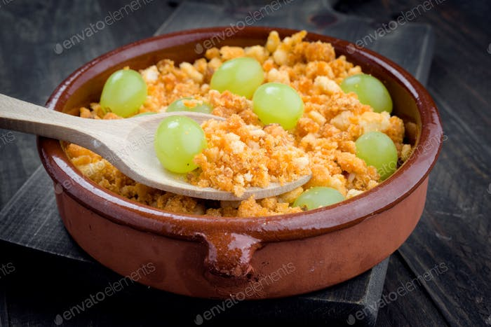 bread crumbs cooked with grapes, typical stew of the shepherds of Navarra, Spain