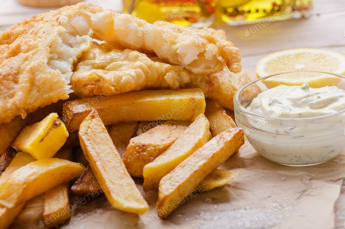 Traditional British street food fish and chips with tartar sauce