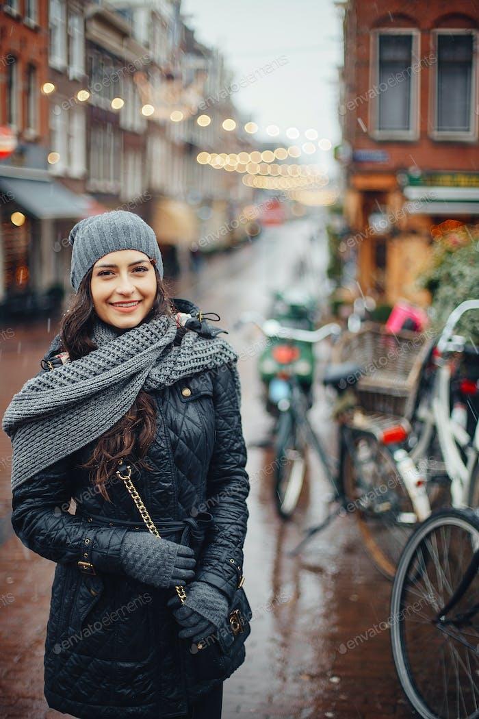 female tourist walking around and exploring Amsterdam