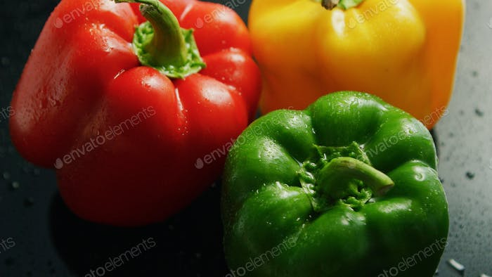Colorful bell peppers in drops