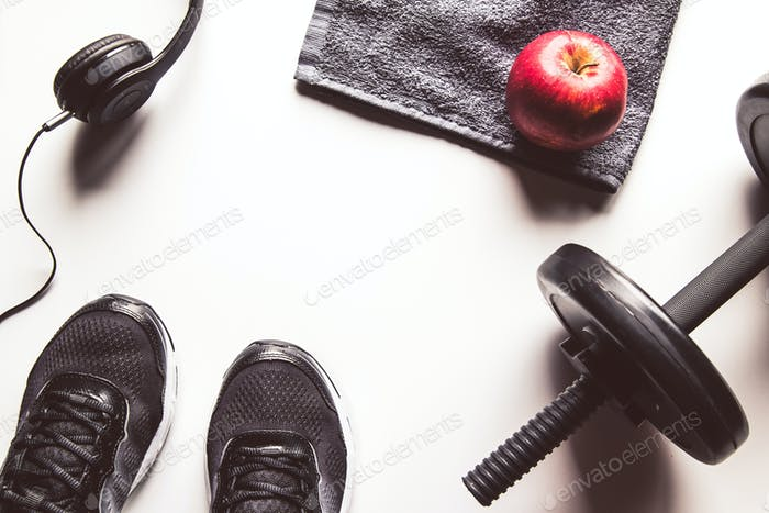 Fitness concept background with sneakers, water bottle. Top view with space for your text