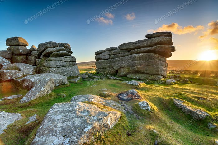 Beautiful sunset over granite rock formations at Combestone Tor