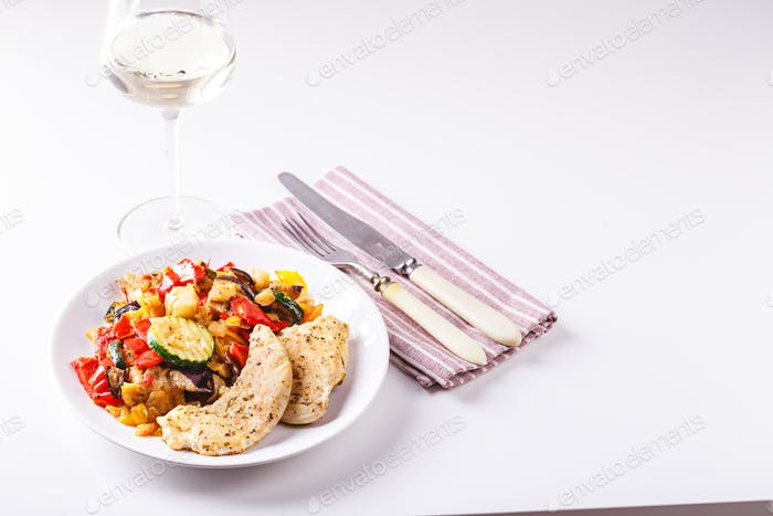 Grilled vegetables and fried chicken breast