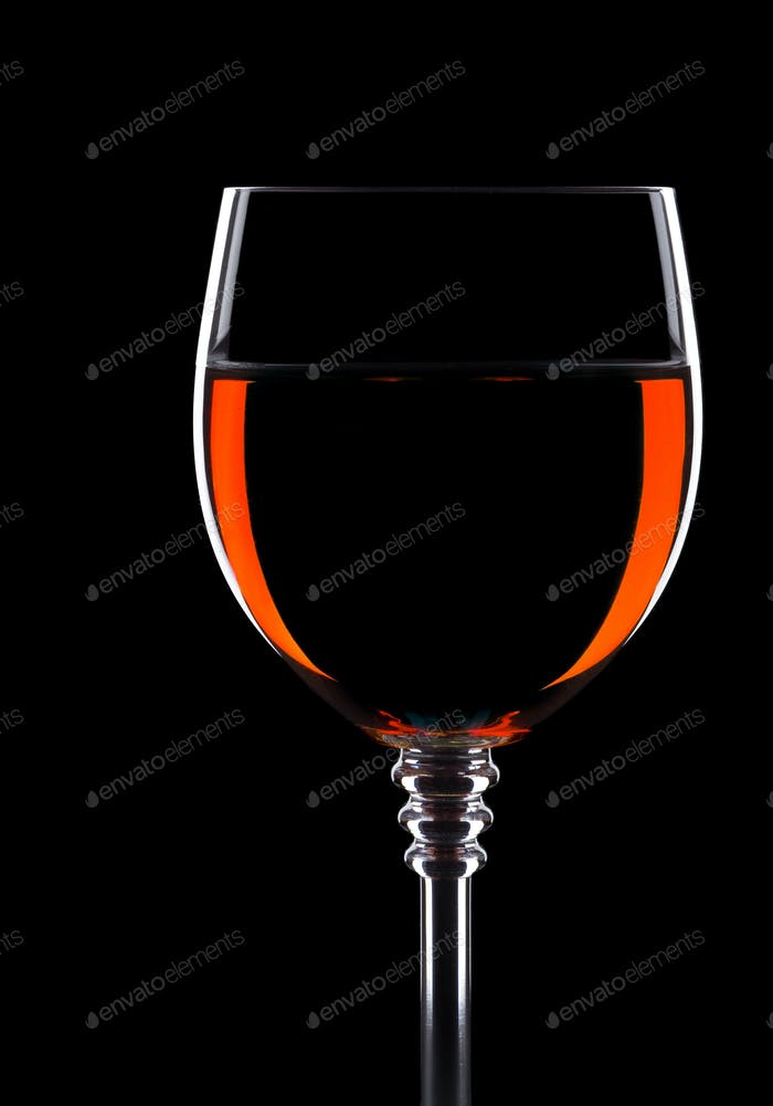 wine in glass isolated on black