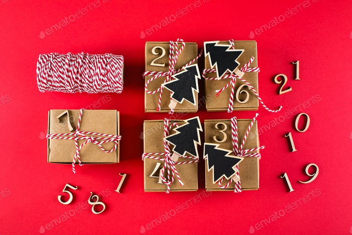 Preparation of advent calendar. Advent christmas calendar. Wrapped gifts. Top view, flat lay