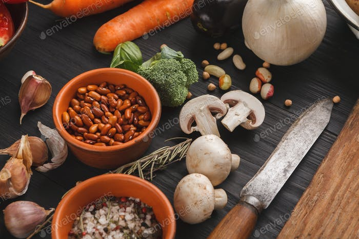 Fresh organic vegetables and wooden desk background