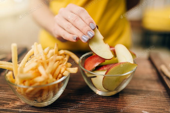 Female person hand with apple piece, healthy food