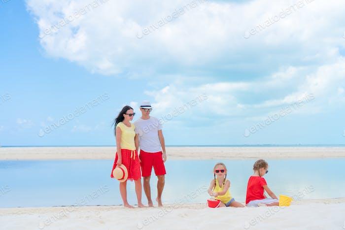 Family of four on a tropical beach