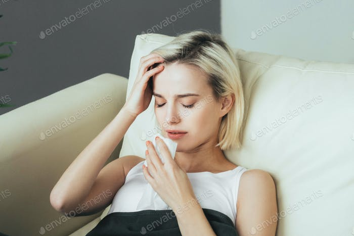Woman sick in bed. Female portrait ill  in bedroom