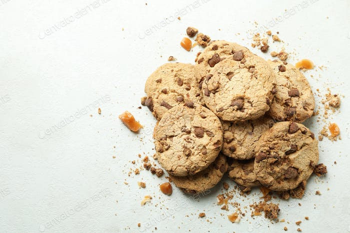 Cookies with caramel on white textured background